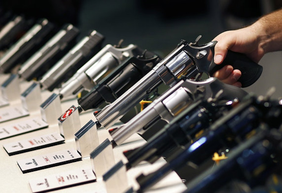 Handguns are displayed at a trade show in Las Vegas. The Supreme Court is granting a case on gun rights for the first time since 2010. CREDIT: JOHN LOCHER/AP