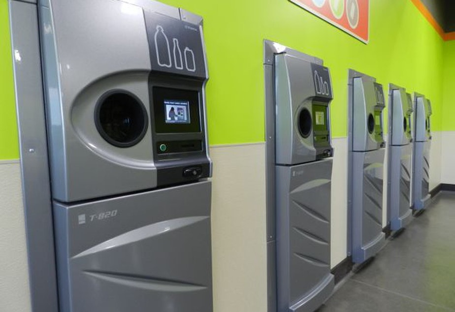 A row of sparkling clean reverse vending machines greet customers at the grand opening of the Medford BottleDrop center.CREDIT: JES BURNS/EARTHFIX