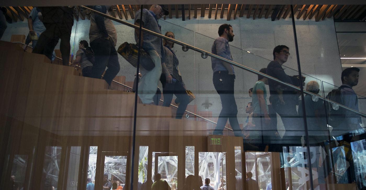 Employees walking in Amazon's Seattle headquarters.