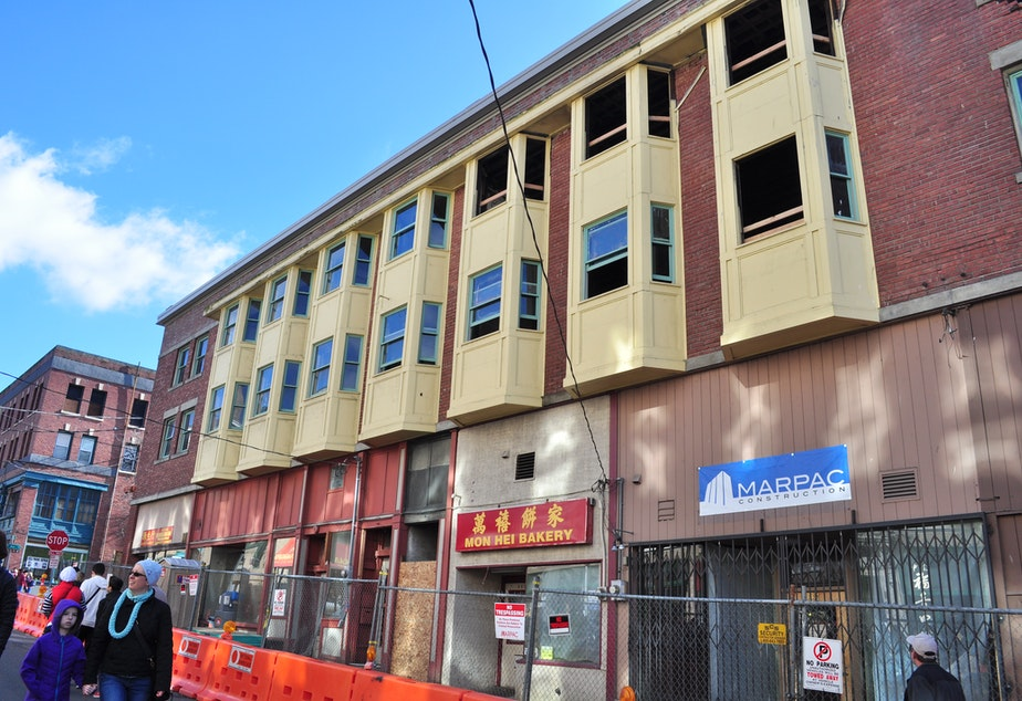 caption: The Louisa Hotel in 2015, two years after a fire devastated half the building.