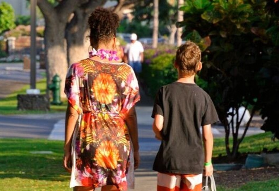 caption: A family photo of Adina and her son Ruben walk back from a day at the pool. Now Ruben is a teenager and has been experimenting with drugs.