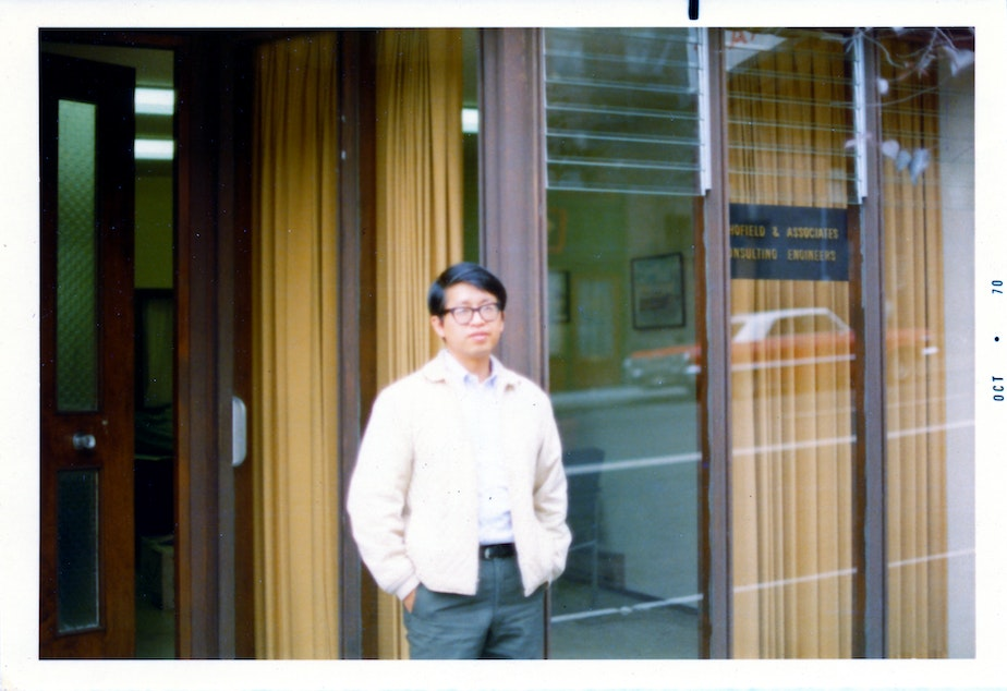 caption: Paul Woo stands in front of the Louisa Hotel building where he ran a law office (photo circa 1970).